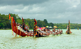 Snake  Boat races of Kerala. People in traditional dress rowing the snake boats in Aranmula boat race in Kerala, India Stock Image