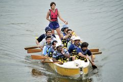 Snake Boat Rowers. A group of Malayalee rowers practicing at the Jurong Lake in Singapore Stock Photography