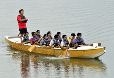 Snake Boat Rowers. A group of Malayalee rowers practicing at the Jurong Lake in Singapore Stock Photos