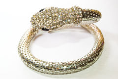 Snake bracelet. Metal bracelet in the form of a snake decorated crystals royalty free stock photos