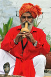 Snake charmer. With his cobra snake Royalty Free Stock Photo