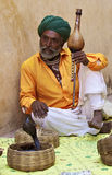 Snake charmer. India. Rajasthan. Snake charmer on the street. India Royalty Free Stock Images