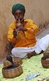 Snake charmer. India. Rajasthan. Snake charmer on the street. India Stock Images