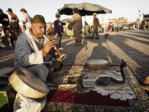 Snake Charmer. Marrakesh - MAR 28: Snake charmer at Djemaa el-Fna square, Morocco on Mar 28, 2013 Stock Photos
