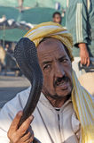 Snake charmer n Marrakesh. Snake charmer at the Jemaa el-Fnaa square in Marrakesh. November 22, 2008 in Marrakesh, Morocco Stock Photo