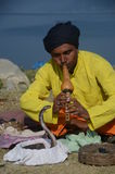 Snake charmer in Nepal. Snake charmer performs on the shores of Phewa lake in Pokhara, Nepal Stock Images