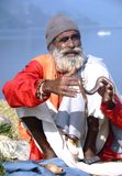 Snake charmer in Nepal. Snake charmer performs on the shores of Phewa lake in Pokhara, Nepal Royalty Free Stock Photo