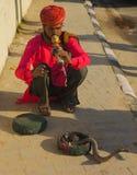 Snake charmer. Outside Amber Fort Royalty Free Stock Photo