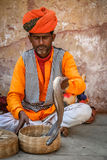 Snake charmer. Performing on the street in Jaipur in Rajasthan, India Royalty Free Stock Photo