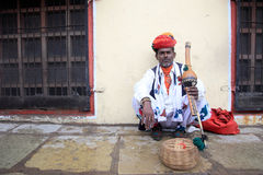 A Snake charmer performs in front of Jantar Mantar Royalty Free Stock Photography