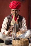 A snake charmer is playing the flut for the cobra Royalty Free Stock Images