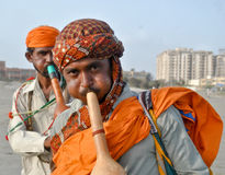 Snake charmers. Playing their musical instrument 'Been to attract people at seaside Royalty Free Stock Images