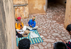 Snake charmers entertain the audience with a presentation of cobras Stock Photography