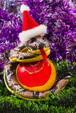 Snake and Christmas balls Royalty Free Stock Photos
