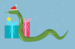 Snake in a Christmas cap Royalty Free Stock Images