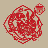 Snake coils rabbit paper cutting Stock Images