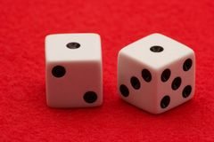 Snake Eyes. Two white dice displaying a total of two snake eyes on red felt royalty free stock photo