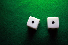 Snake Eyes. Dice over a green table showing snake eyes Stock Image