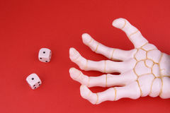 Snake Eyes. Hand of Death rolls snake eyes, part of gambling abuse series Stock Images