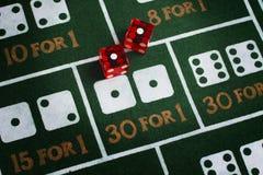 Snake Eyes. Casino dice roll snake eyes on a craps table felt royalty free stock photo