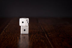 Snake Eyes - Dice on Wood Table Background. Dice stacked on wood table background - Snake Eyes royalty free stock photos