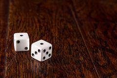 Snake Eyes - Dice on Wood Table Background. Dice thrown on wood table background - Snake Eyes royalty free stock photography