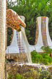 Snake fountain Barcelona Gaudi. Mosaic snake fountain at the Parc Guell designed by Antoni Gaudi located on Carmel Hill, Barcelona, Spain royalty free stock photography