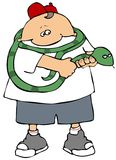 Snake Handler. This illustration depicts a boy holding a large green snake Stock Photos
