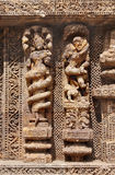 A Snake hooded sculpture and an amorous couple. Konark Sun Temple  also known as the Black Pagoda ia a 13th-century Sun Temple at Konark, in Orissa.The entire Royalty Free Stock Photos