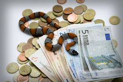 Snake and money. Snake and some money in time of crisis Royalty Free Stock Photography
