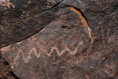 Snake Petroglyph is an ancient rock drawings at Irish Canyon in Colorado stock images
