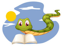 A snake reading Stock Photo