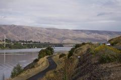 Snake River between the adjoining cities of Lewiston, Idaho and Clarkston, Washington. Bridge over the Snake River connecting the the adjoining cities of Royalty Free Stock Image