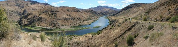 Snake River. The Snake River is a major river of the greater Pacific Northwest region in the United States. At 1,078 miles long, it is the largest tributary of royalty free stock images