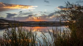 Snake River Sunset. The sun sets on the Snake River at Three Island State Park, Glenn`s Ferry, Idaho, USA royalty free stock photography