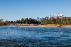 Snake River and Tetons in Autumn. The scenic mountain landscape of the snow capped tetons and the snake river in fall Stock Photos