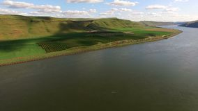 Snake River Valley Landscape Washington State Agriculture Industry Rail Transportation. Soft clouds roll along on a beautiful day in Eastern Washington over the stock video