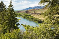 Snake RiverCliffsin Idaho. Snake River Valley cliffs in Idaho with trees and clouds royalty free stock photo