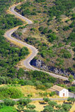 Snake road, Kythera, Greece. One of many winding snake-like roads found in the beautiful island of Kythera Greece. This road leads to the village of Mitata, a Stock Photo