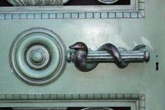 Snake signet on metal door stock images