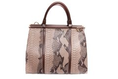 Snake skin leather bag Stock Photo