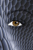 Snake skin texture painted on face Stock Photo