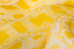 Snake Skin Yellow. Lose-up shot of an albino python snake skin pattern Royalty Free Stock Photo