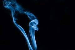 Snake in smoke. The smoke looks like snake shape while taking smoke photography using off camera flash in slave mode stock image