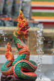 Snake Statue, Naga Thai Statue Blurred Background. Naga Thai Statue spray Water in Blurred Background, Closeup Stock Photography