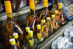 Snake Whiskey For Sale at Bến Thành Market in Ho Chi Mihn City. Rice wine, vodka or grain alcohol infused with snakes usually a Cobra and/or a Cobra holding a Stock Images