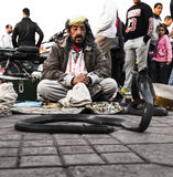 Snake whisperer in Jemaa El-Fna square Royalty Free Stock Photos