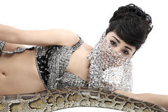 Snake woman. Belly dancer dancing with python Royalty Free Stock Image