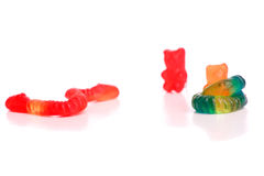Snakes fighting with gummy bears Stock Photo