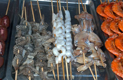 Snakes and frogs at Donghuamen Night Market, Beijing, China Stock Photos
